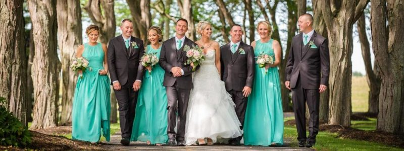 whole bridal party holding hands