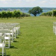 Wedding ceremony setup in the vineyard.